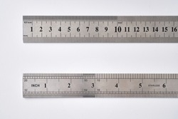 Stainless metal rulers on white background