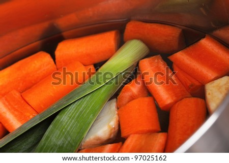 stainless pot boiled carrot vegetables soup background - stock photo