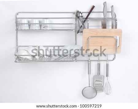 Stainless shelf with kitchen utensil on the white background