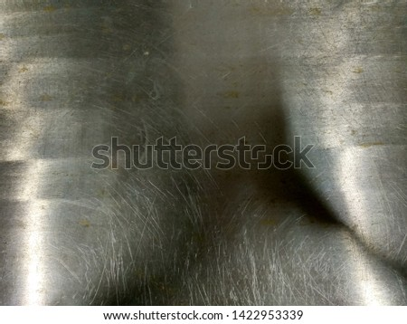 Stainless steel background. Stainless steel floor with rust island.