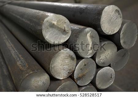 Stainless steel bars deposited in stacks