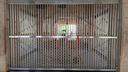 Stainless steel chromium gate,temple outdoor gate, ornamented white fence,beautiful iron texture. It is safety gate outside of Hindu temple.