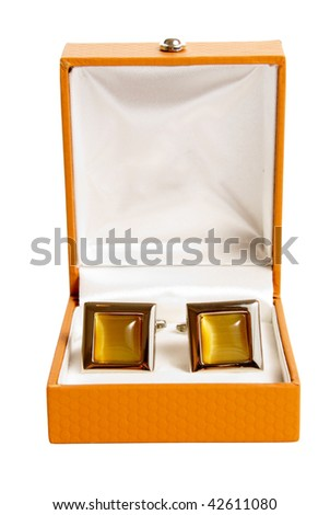 stainless steel cufflinks on the brown leather box isolated on white background