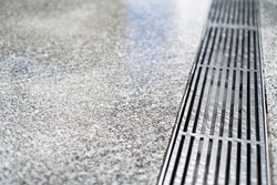 stainless steel floor drain with rain water drop with concrete floor with copy space for text