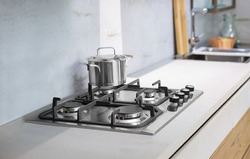 Stainless steel gas stove in the kitchen with a pan