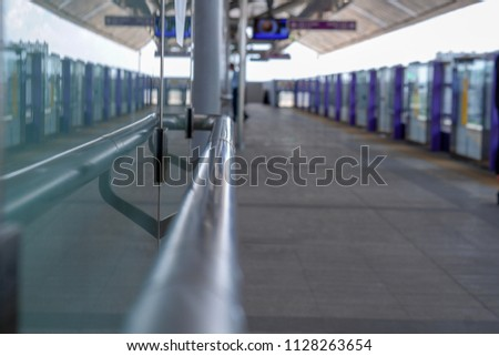Stainless steel handrail in the electric train station, Living in the city, skytrain is another alternative to traveling in a hurry. Select focus, Soft focus,  Blurry focus #1128263654