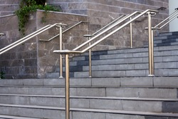 Stainless steel handrails are installed on the walls and steps.
