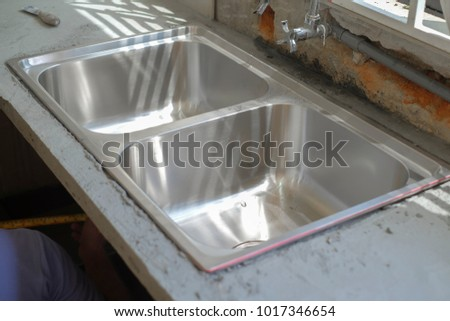 Stainless steel installation for kitchen. #1017346654