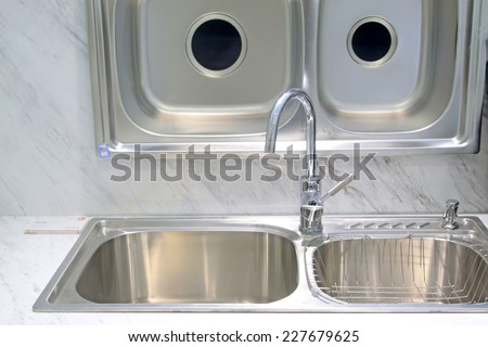 stainless steel kitchen cooking pots, closeup of photo