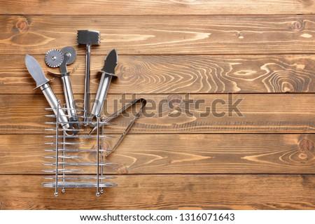 Stainless steel kitchen utensils on wooden table #1316071643