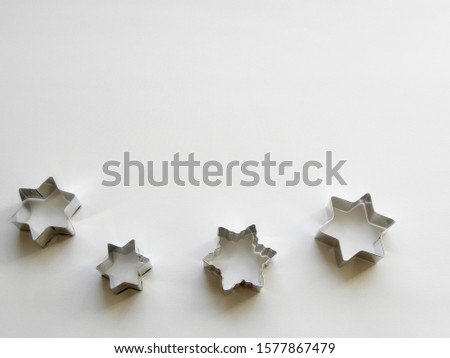 stainless steel molds for baking christmas cookies. Stars isolated on white background #1577867479