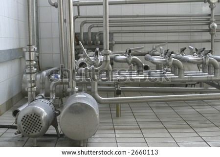 stainless steel pipes and valves in modern dairy