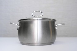 Stainless steel pot, stockpot on white table, eco friendly kitchen utensils without harm, harmless safe for people
