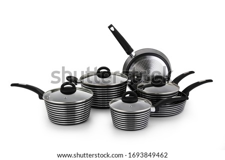 Stainless steel pots and pans isolated on white background Foto stock ©