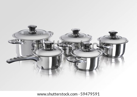stainless steel pots and pans on white