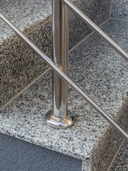 Stainless steel railing detail with floor fixing and stair tread with granite support