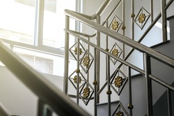 Stainless steel railing inside a building.