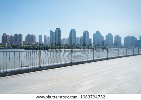 stainless steel railings and granite brick floor on huangpu riverside #1083794732
