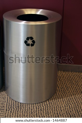 Stainless steel recycle bin with recycling sign on the side. Includes a clipping path.
