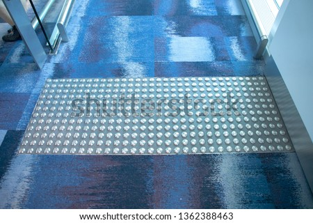 Stainless steel Tactile paving with textured ground surface with markings, indicators for blind and visually impaired. Blindness aid, visual impairment, independent life concept.