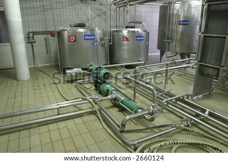 stainless steel temperature controlled pressure tanks and valves in factory