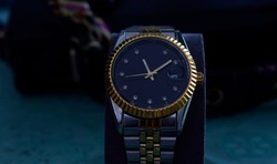 Stainless steel watch set with diamonds There are brands that are rare, expensive. Placed on the floor are classic vintage fashion accessories.