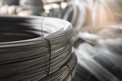 Stainless Steel wire Rolls in the construction site. Closeup of Metal Steel reinforced rod for concrete in store. Construction Concept.