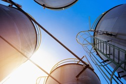Stainless tanks and pipeline for liquid chemical industrial on blue sky background