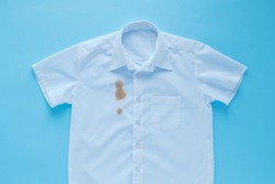 Stains from soy sauce on a white shirt