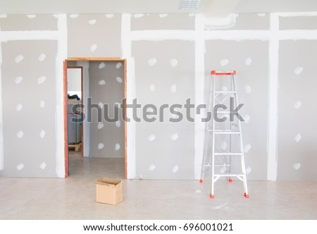 stair and gypsum board wall interior decoration of home at construction site with copy space add text #696001021