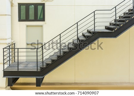 stair for fire escape with the steel railing and ladder on side of building stock photo