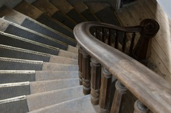 Stair treads to protect the old and worn stairs and a beautiful curved banister with spindles