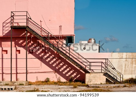 Staircase against pink wall at the Flamingo Visitor Center in Everglades National Park near Homestead, Florida