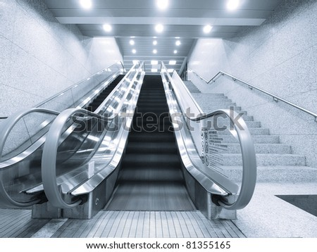 Staircase and escalator in underground passage
