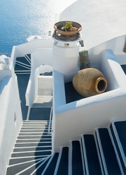 Staircase between the terraces of Firostefani, Santorini at sunset, Greece