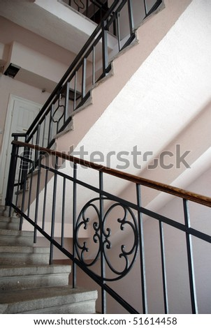 staircase fragment with metallic railings indoor