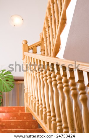 Staircase in a house with wooden balusters.