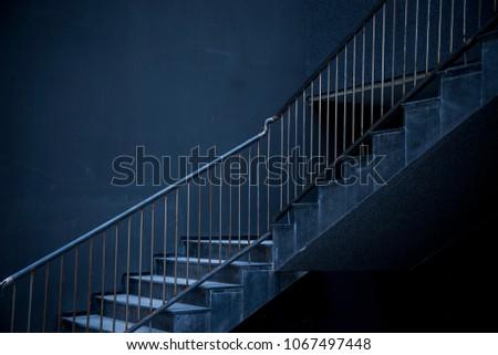 Staircase in monochromatic dark tones #1067497448