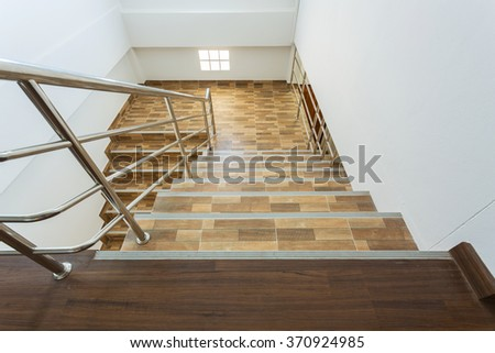 Staircase In Residential House With Stainless Steel Banister, Ceramic Floor  Tiles Wood Pattern #370924985