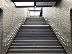 Staircase leading to a platform in a suburban train station in Paris, France