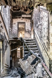 Staircase of burnt down house, heavy decay