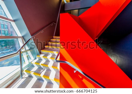 Staircase painted in red. Abstract fragment of urban architecture of modern luxury building, hotel, shopping mall, business center.   Interior design. #666704125