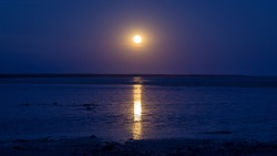 Staircase to the moon in Broome, Western Australia. It is a natural phenomenon which occurs when a full moon rises over the exposed tidal flats of Roebuck Bay.