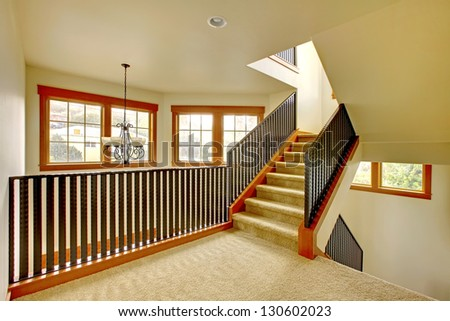 Staircase with metal railing. New luxury home interior.