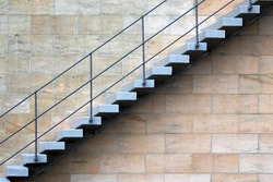Staircase with the rails on the wall