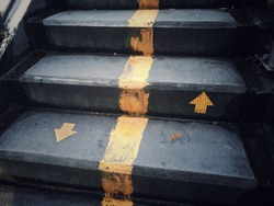 staircase with up and down arrow signs on the ground, for any work about construction, people's, life, business, and abstract concept background.
