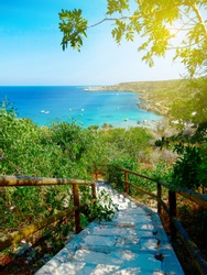 staircases to sandy beach coast in the mediterranean sea landscape on Cyprus island