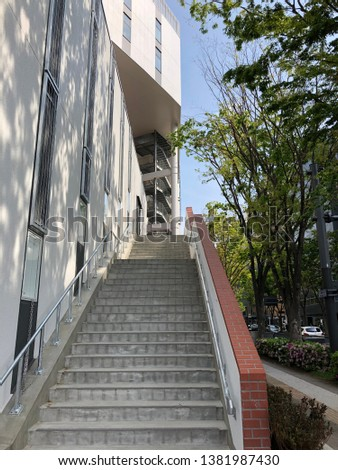 stairs and trees of a modern building #1381987430