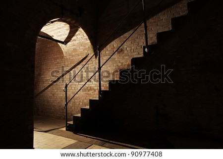 Stairs and underground corridor in old industrial building.