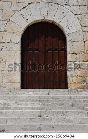 Stairs and wooden door of an old building